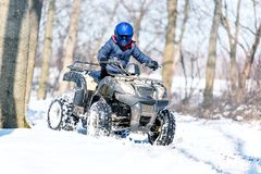 Travel in the winter on the ATV. Beautiful winter nature stock image