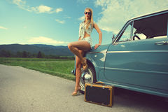 Travel woman. Fashion model with vintage cars, summer travel Stock Image