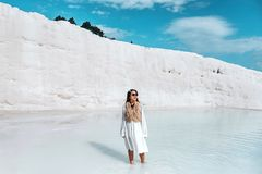 Travel woman enjoying Pamukkale tranvanter pools at ancient Hierapolis , Denizli