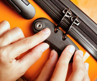 Woman locked her luggage in the orange suitcase Royalty Free Stock Images