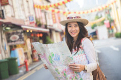 Travel woman look map Stock Photo