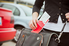 Travel: Woman Pulls Travel Ticket Out Of Bag Royalty Free Stock Images