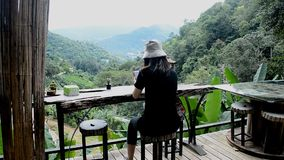 Travel woman relax, enjoy scene and playing with mobile phone. At natural park stock video footage