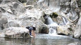 Woman rest on rock, enjoy water stock video footage