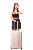 Travel. Woman with suitcase looking at wrist watch. Royalty Free Stock Images