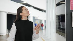 Travel woman using smartphone at airport. Young caucasian traveler checking boarding time with mobile phone app in. Travel woman using smartphone at airport stock video
