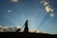 Travel women with luggage. Woman travel silhouette blue sky stock image