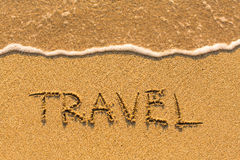 Travel - word drawn on the gold sand beach Stock Image