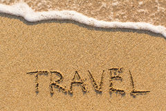 TRAVEL - word drawn on the sand beach Stock Images