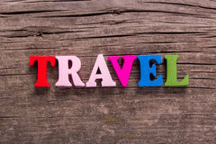 Travel word made of wooden letters Stock Photos