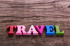Travel word made of wooden letters Royalty Free Stock Photo