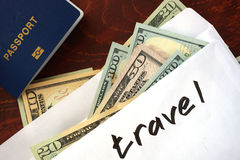 Travel written on an envelope with dollars. Savings concept Royalty Free Stock Photography