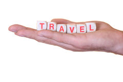 Travel written with wooden dice on a hand, isolated on white background Stock Photography
