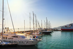 Travel yachts in harbor Stock Images