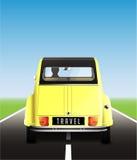 Travel - yellow retro car on road Royalty Free Stock Photography