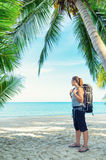Young female backpacker on a beach Stock Photography