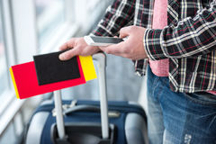 Travel. Young man with a suitcase and passport ready to travel Royalty Free Stock Images