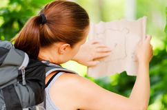 Young woman with backpack in a woods Royalty Free Stock Photo