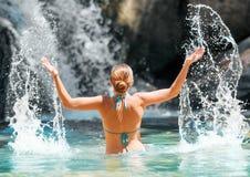 Young woman having fun in waterfall Royalty Free Stock Image