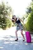 Travel young woman hitchhiking. Stock Photo