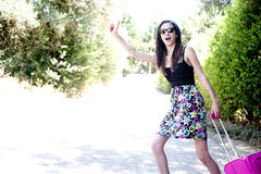 Travel young woman hitchhiking. Stock Image