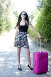 Travel young woman hitchhiking. Royalty Free Stock Images