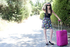 Travel young woman hitchhiking. Royalty Free Stock Photo