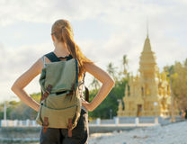 Young woman looking at golden pagoda Royalty Free Stock Image