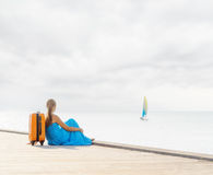 Young woman sitting on wooden pier Royalty Free Stock Photo