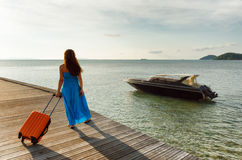 Young woman with suitcase on the pier Royalty Free Stock Photography