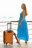 Young woman with suitcase on the pier Royalty Free Stock Image
