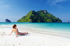 TYoung woman on a tropical beach Stock Image
