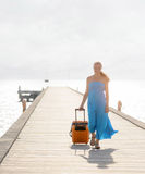 Young woman walking on wooden pier Stock Image
