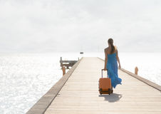 Young woman walking on wooden pier Stock Photography