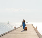 Young woman walking on wooden pier Royalty Free Stock Photo