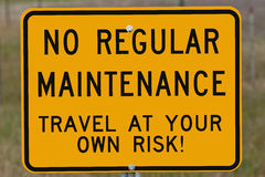 Travel at Your Own Risk Sign Royalty Free Stock Image