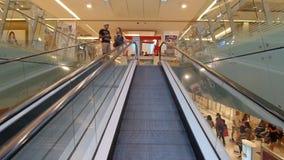 Travelator Inside Mall. FIUMICINO, ITALY - SEPTEMBER 2, 2016: Pople using travelator inside Parco Leonardo shopping center stock video footage