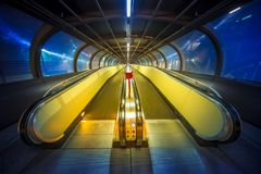 Travelator moving walkway tunnel dynamic perspective, Rollbahn royalty free stock images