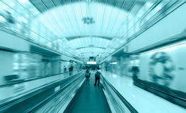 Travelator with passengers in airport Stock Photos