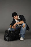 Traveler. There is glamorous boy with travel bag stock images