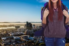 Traveler above the city. Digital composite of traveler in city Royalty Free Stock Images