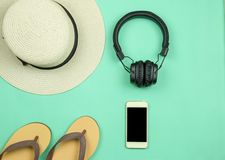 Traveler accessories on green background. Flat lay. royalty free stock photo