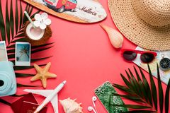 Traveler accessories on trendy pink background. Bright summer color. Top view. stock image