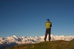 Traveler is admiring the stunning mountain range Royalty Free Stock Photo
