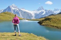 Traveler against Swiss Alps Royalty Free Stock Image