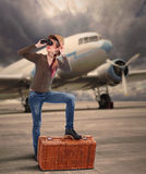The traveler on the airport. Retro style picture of the traveler on the airport against old passenger plane Stock Images