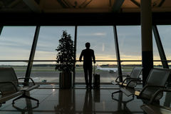 Traveler in the airport. Traveler waiting for his flight in Italian Airport stock photography