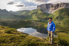 Traveler around the mountain lakes and rocky peaks at sunset Stock Image