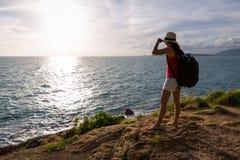 Traveler asia woman on sea cliff Stock Photos