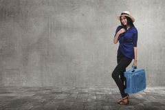 Traveler asian woman with hat and suitcase walking around. On the city Stock Photography